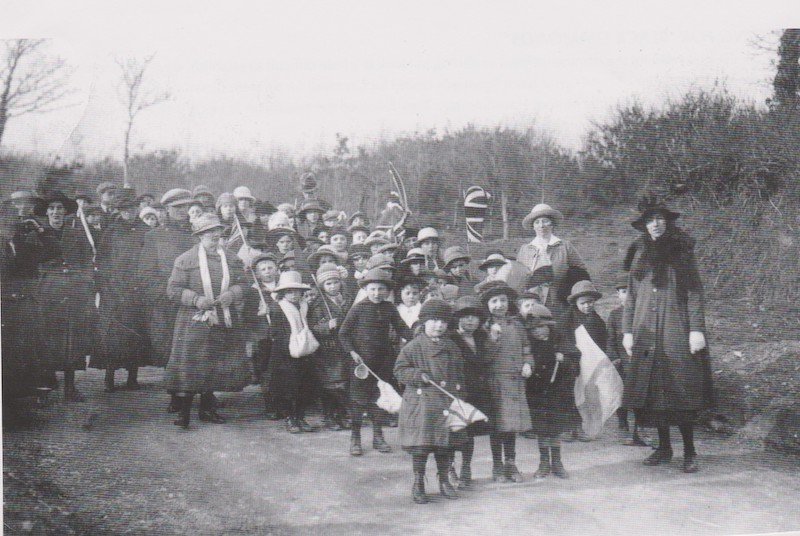 February 9th 1922 and the village children get ready to march along the new road and celebrate a hard fought victory
